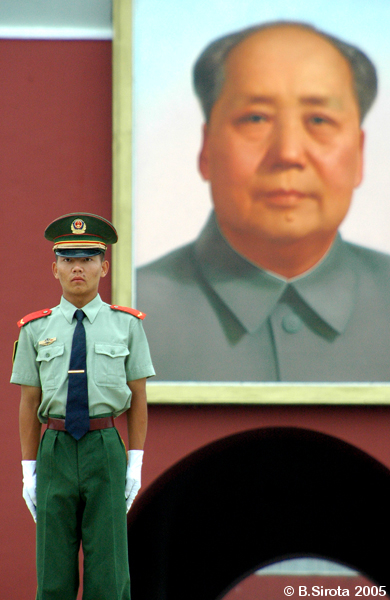 Guard near Mao portrait