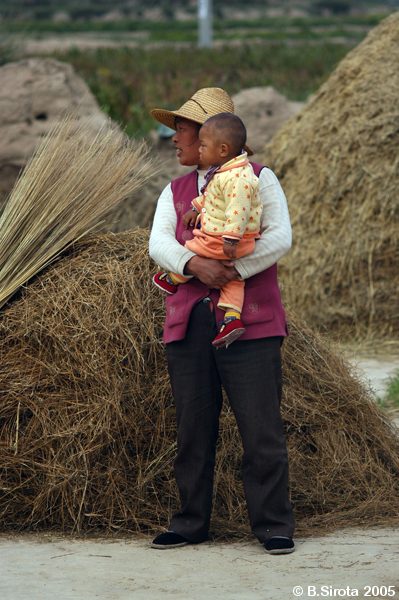 Chinese minority people during autumn harvest
