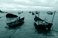 Fishing boats along one of the Penang beaches